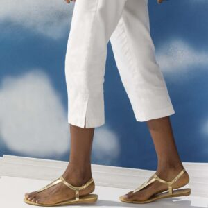 gold sandals and white pants