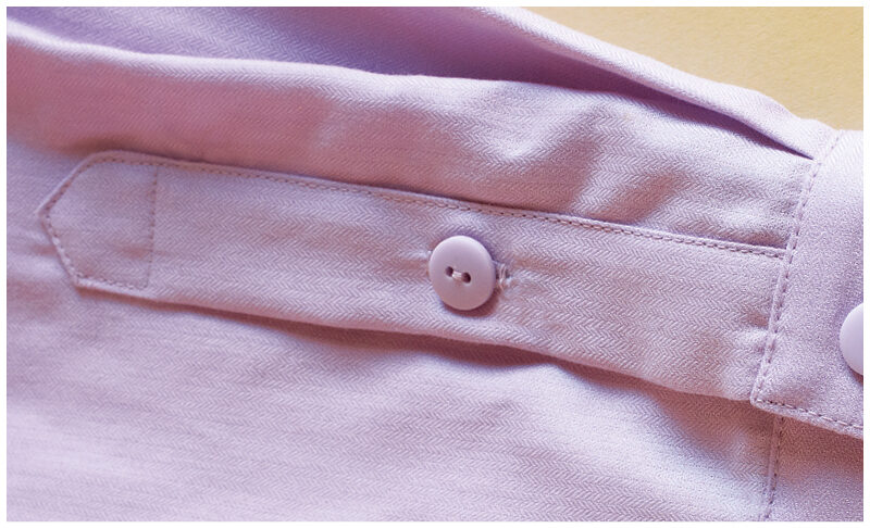 Add a small buttonhole and button to the placket, if desired