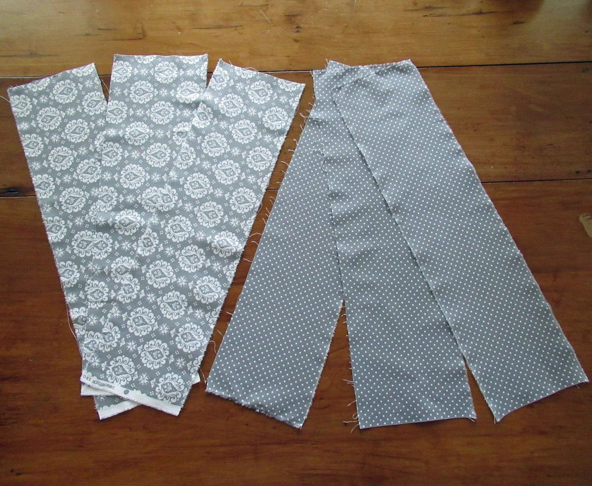 Rip or cut each fat quarter into three 6-inch by 22-inch pieces