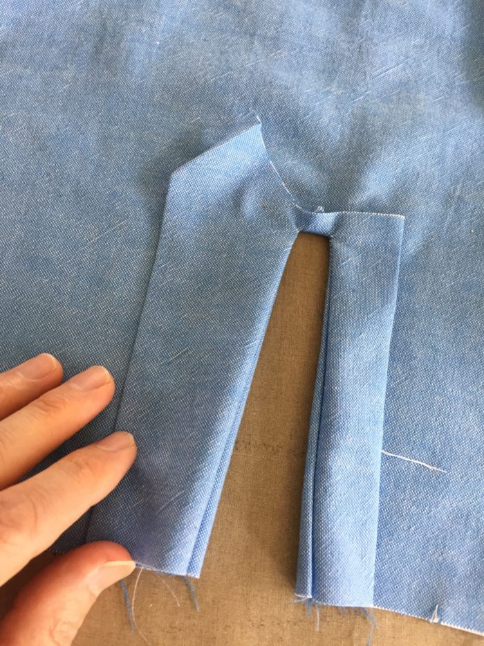 folding the placket to the right side