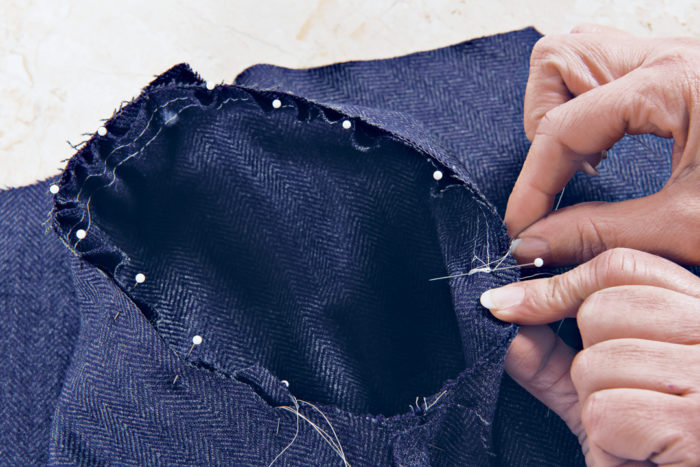 sleeve being pinned to an armhole, interior view