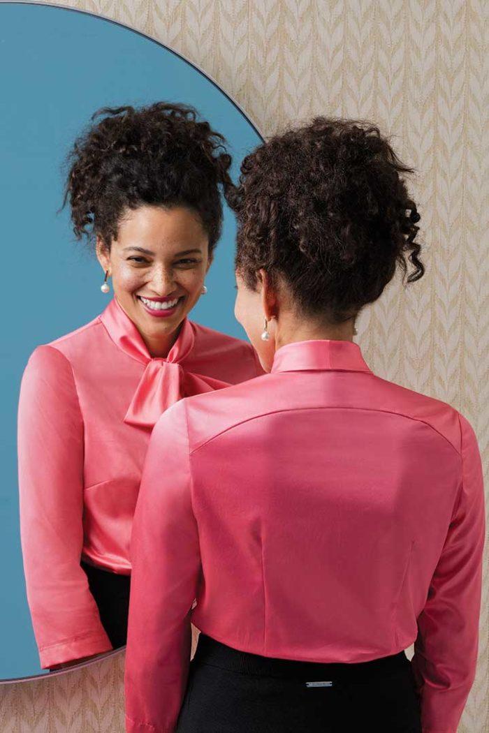 Women in a beautiful pink shirt