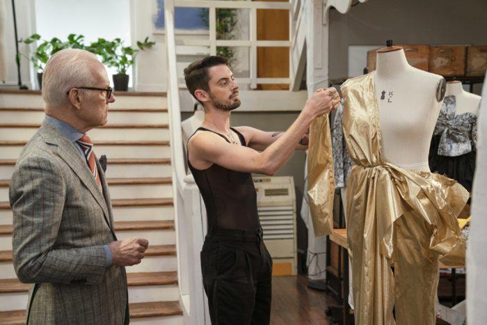 Designer pins flashy gold fabric to dress form to create a dress as Making the Cut show host Tim Gunn observes