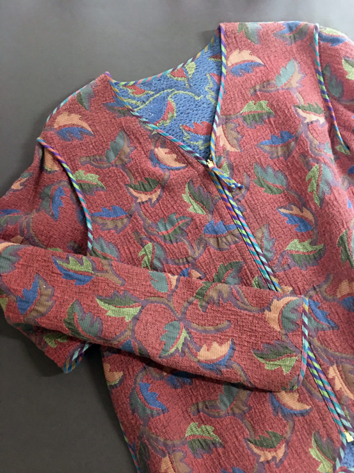 Design experimentation led to the creation of a jacket whose edges are finished with seam binding