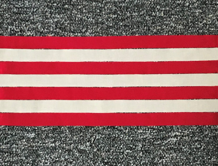 Long strips of red and white fabric vertically aligned