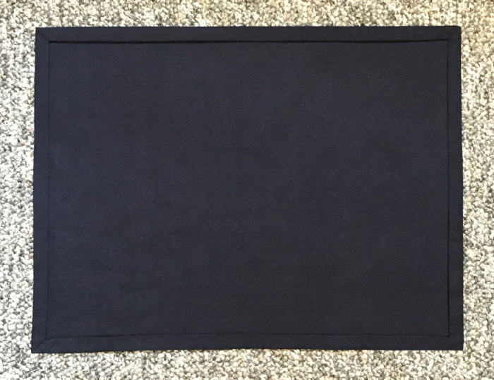 Place mat backing with mitered corners