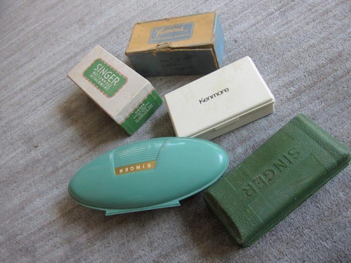 5 vintage buttonholers boxes
