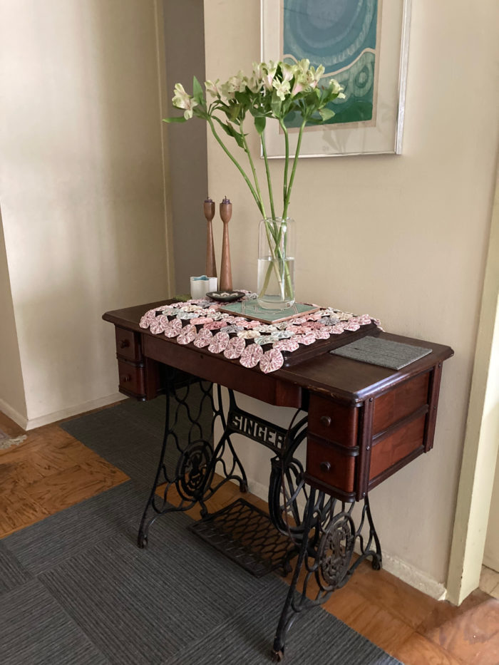 Vintage Singer treadle machine being used as an accent table