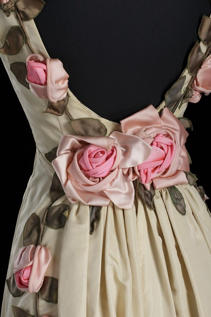 Floral detail on an ivory silk dress designed by Ann Cole Lowe, circa 1966