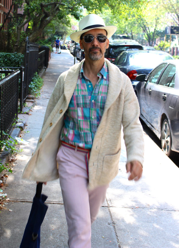 Peter Lappin wearing a shawl-collar sweater, madras shirt, and pink pants, all from his home-sewn wardrobe