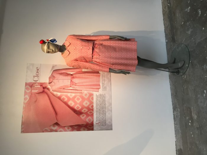 A 1964 jacket and dress with ribbon bow belt with hidden closure