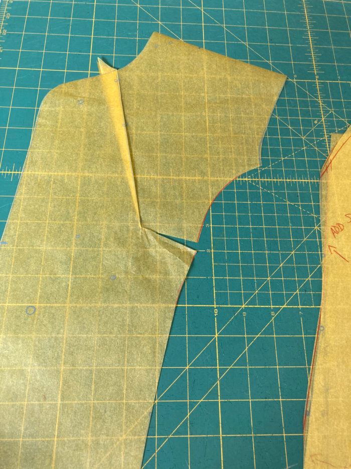 Neck dart on suit jacket pattern piece is closed