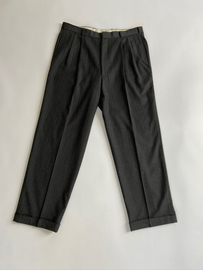 Trousers that are part of a men's suit that will be transfprmed into a different garment or ensemble