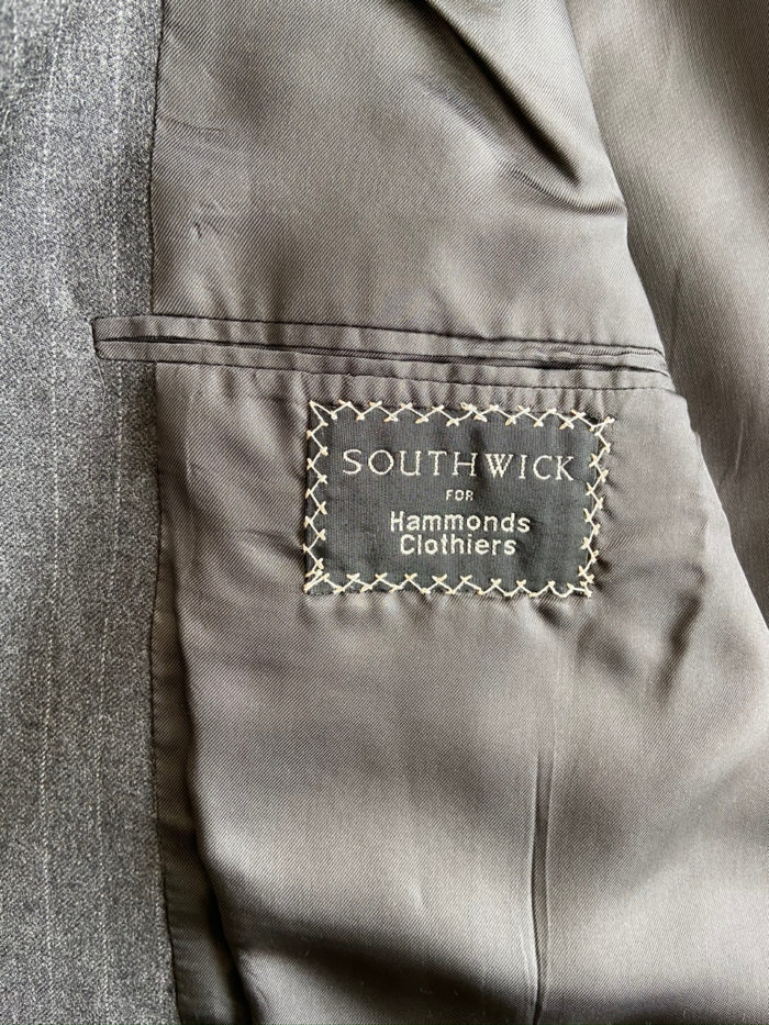 Men's suit brand name is sewn into the jacket's inside front