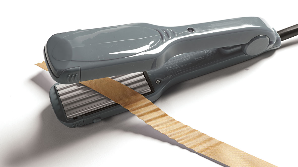 Make a leaf by crimping a folded and tapered strip of fabric. (Conair hair crimper, Kmart.com)
