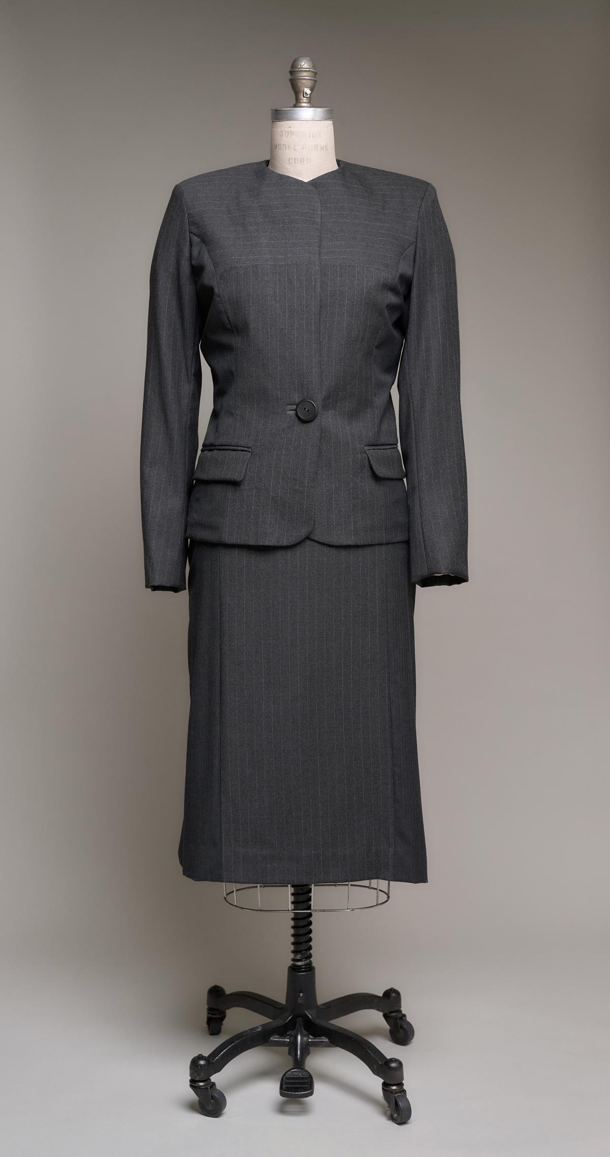 Women's dark gray pinstripe suit on dress form
