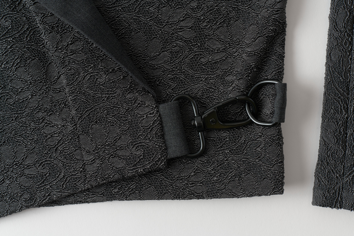 Close-up of buckle closure on women's jacket