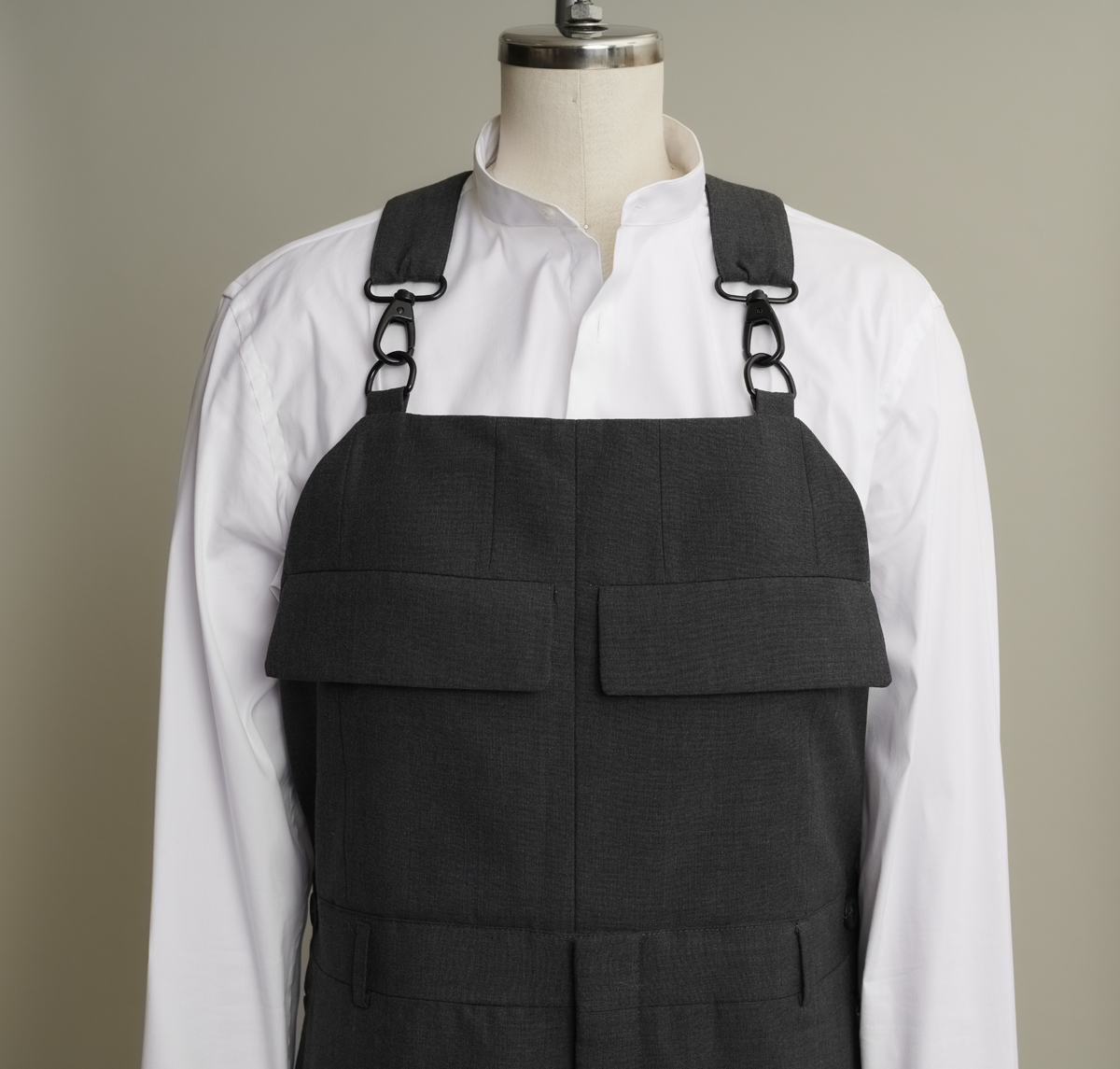 Ovrealls bib with pocket flaps harvested from repurposed men's suit