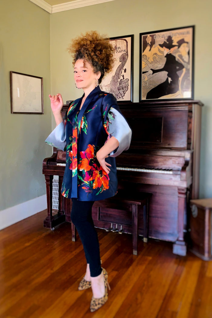 Marcy Harriell modeling evening envelope jacket with origami band sleeves