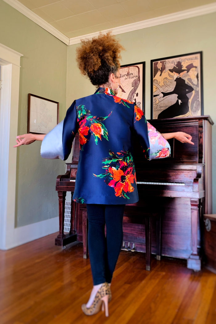 Marcy Harriell showing the back of the evening envelope jacket