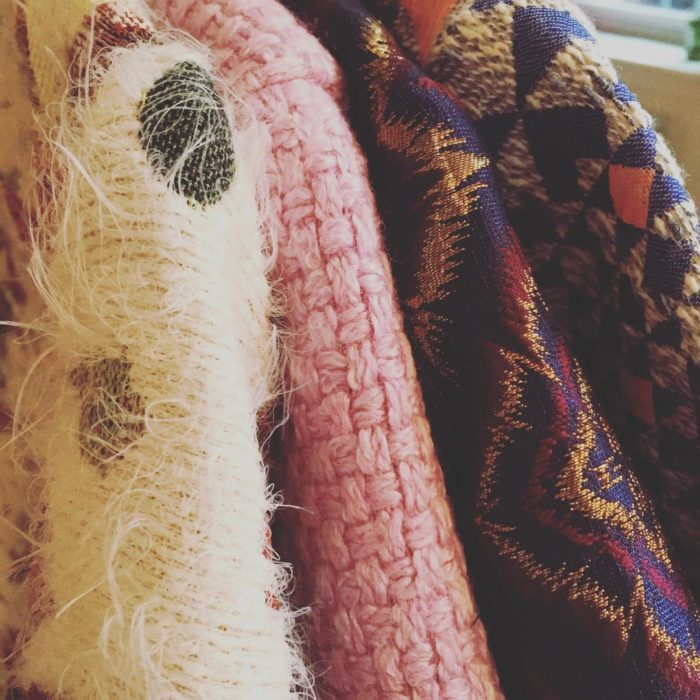 Closeup of four textured wool jacket sleeves