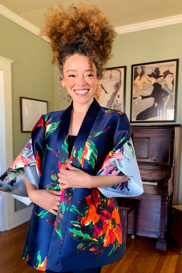 Marcy Harriell wearing a large-scale, colorful print evening envelope