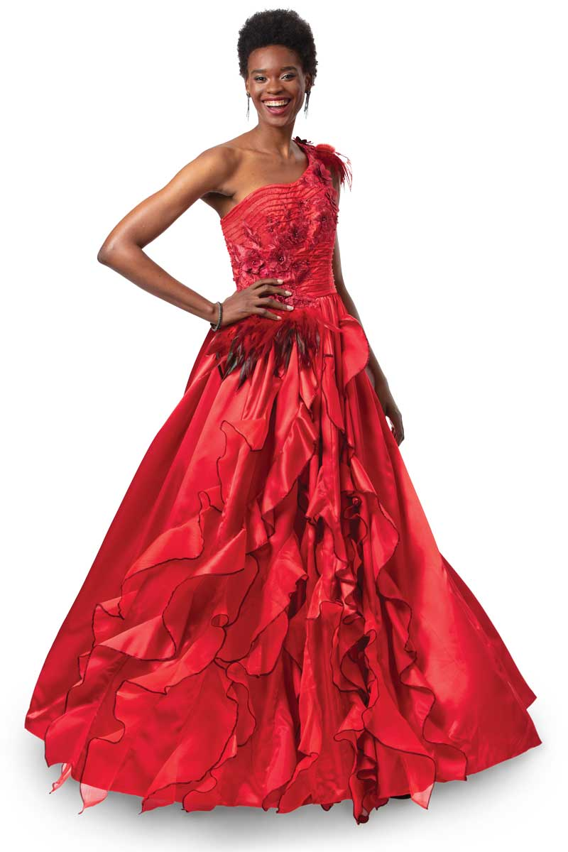 "A classic ball gown gains heat from fiery red satin embellished with ""singed"" feather and lace trims and sparkling crystals."