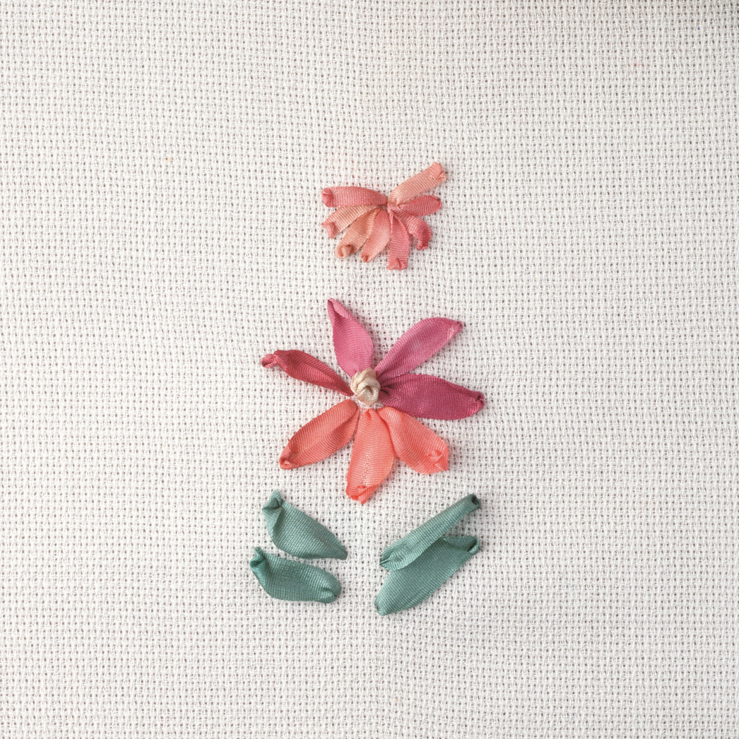 Embroidery done with the ribbon stitch.