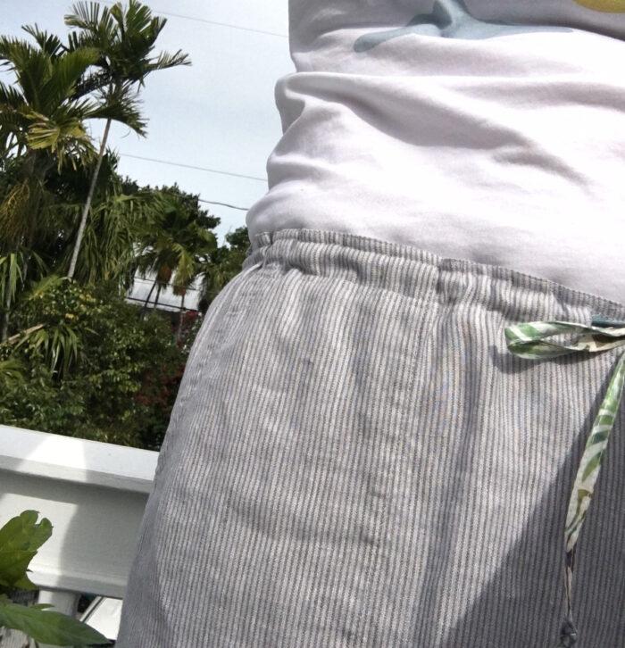 Close-up of drawstring waistband pants being worn