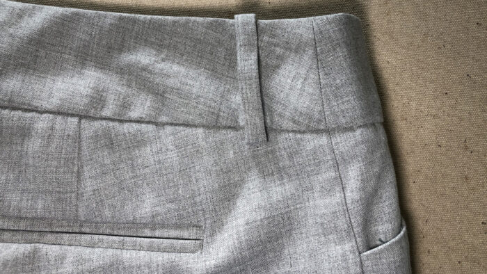 A pair of women's pants has waistband seams at the sides