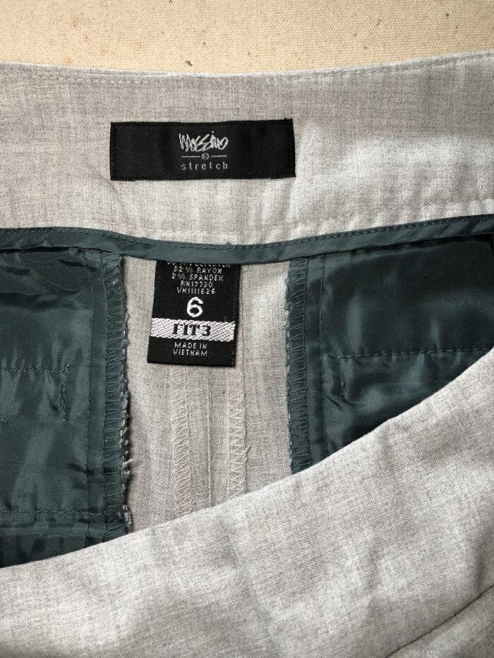 Maker's labels inside the back waistband on women's pants