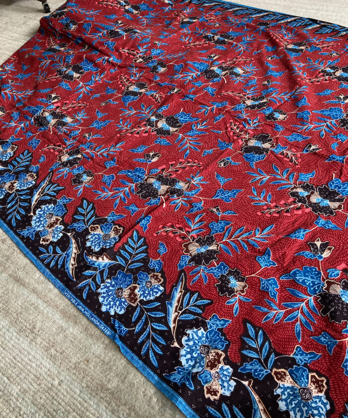 Blue and maroon floral border print.