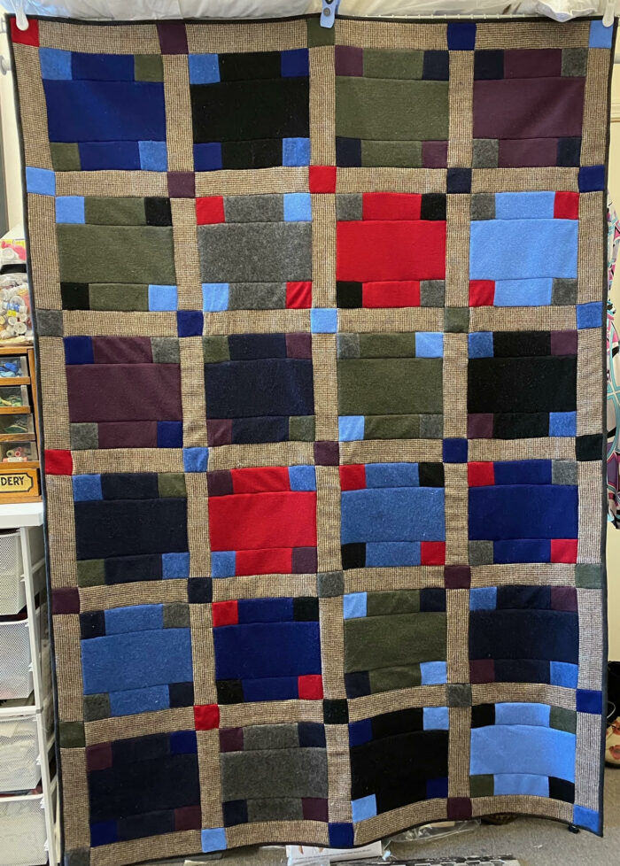 A quilt made from 8 upcycled sweaters.