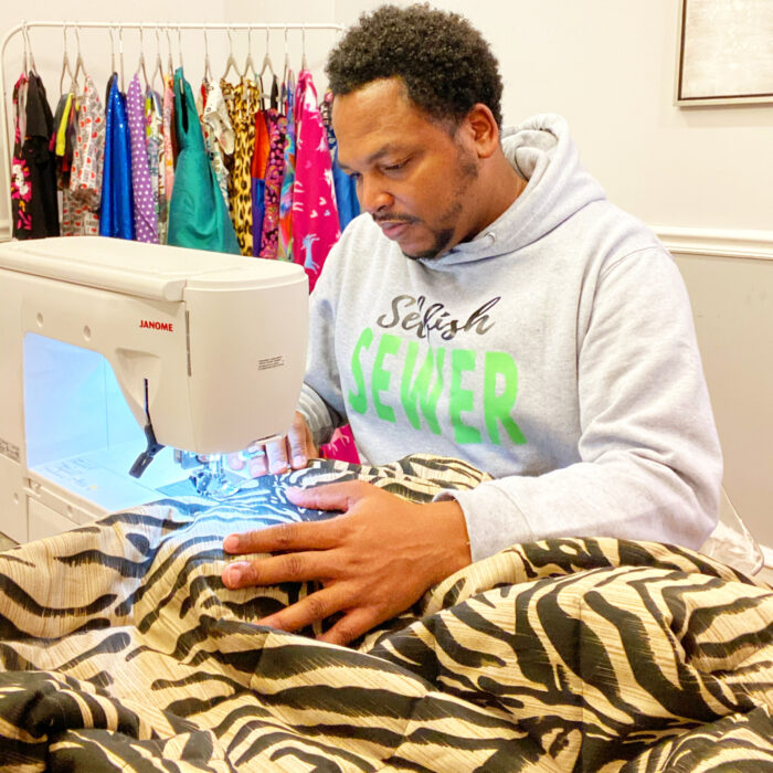 Dad and sewing enthusiast Michael Gardner at the sewing machine, stitching on zebra print fabric
