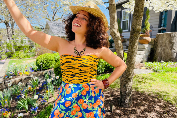 Brilliant decorating: Marcy Harriell standing in front of a blooming dogwood tree wearing a colorful dress