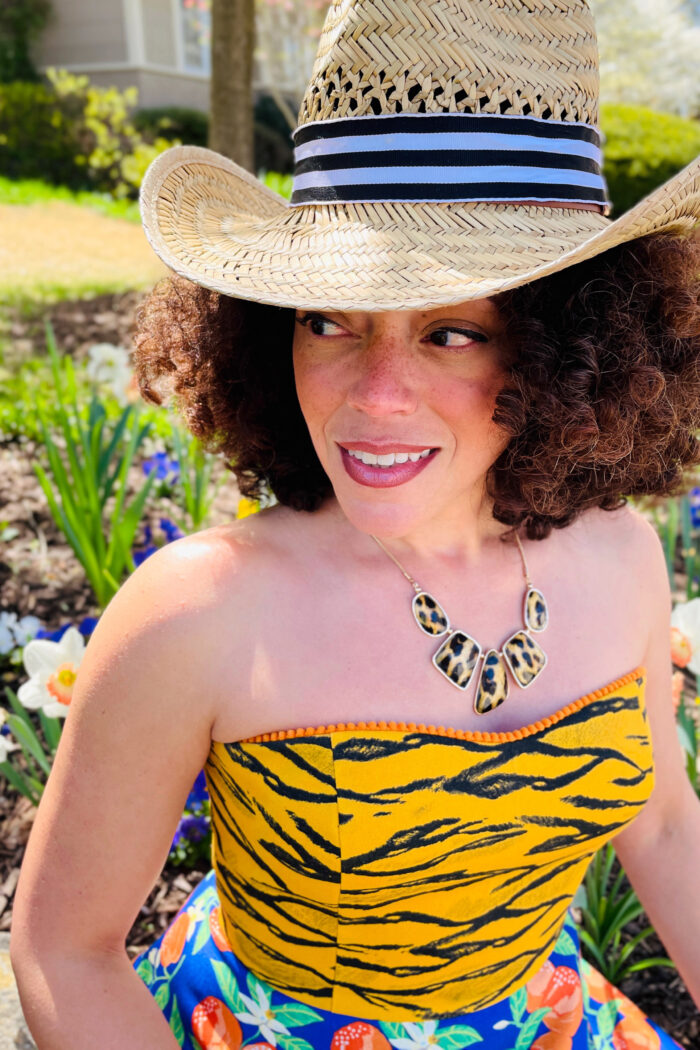 Brilliant decorating: Close-up of Marcy Harriell wearing a straw cowboy hat adorned with a blue striped grosgrain ribbon