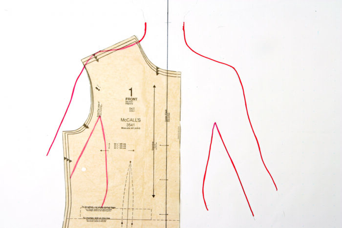 Tracing of upper body overlayed by a bodice pattern piece.