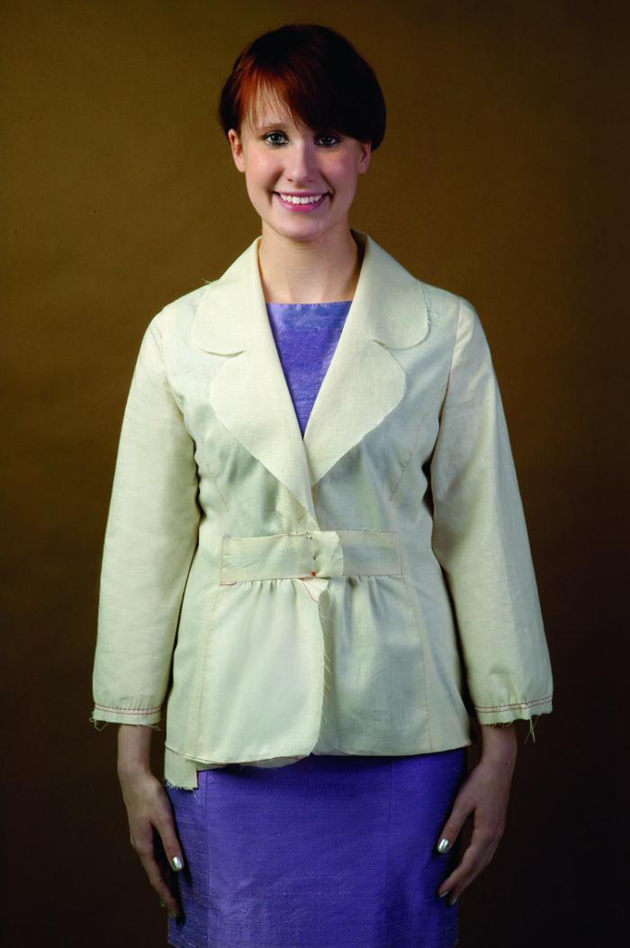 Model wears a jacket test garment, or muslin.