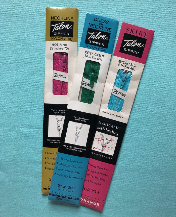 Three types of Talon nylon zippers still in their packages are part of zipper history