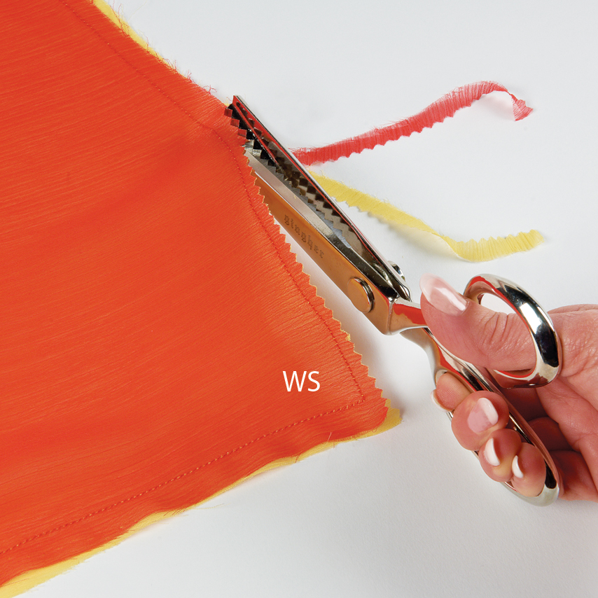 If you sew, rather than serge, the sarong seam, pink the raw edges for a narrow seam allowance that won't fray.