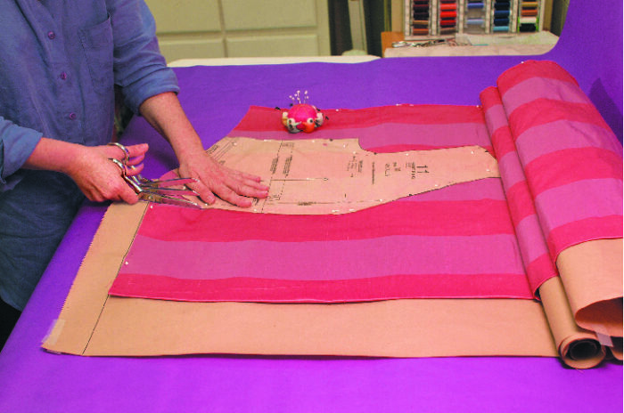 cutting fabric on paper