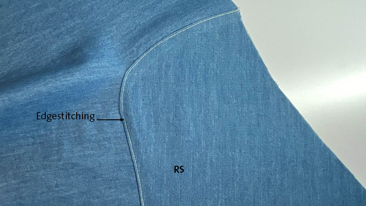 Lapped and appliqued seam: basting stitches removed and edgestitching remains