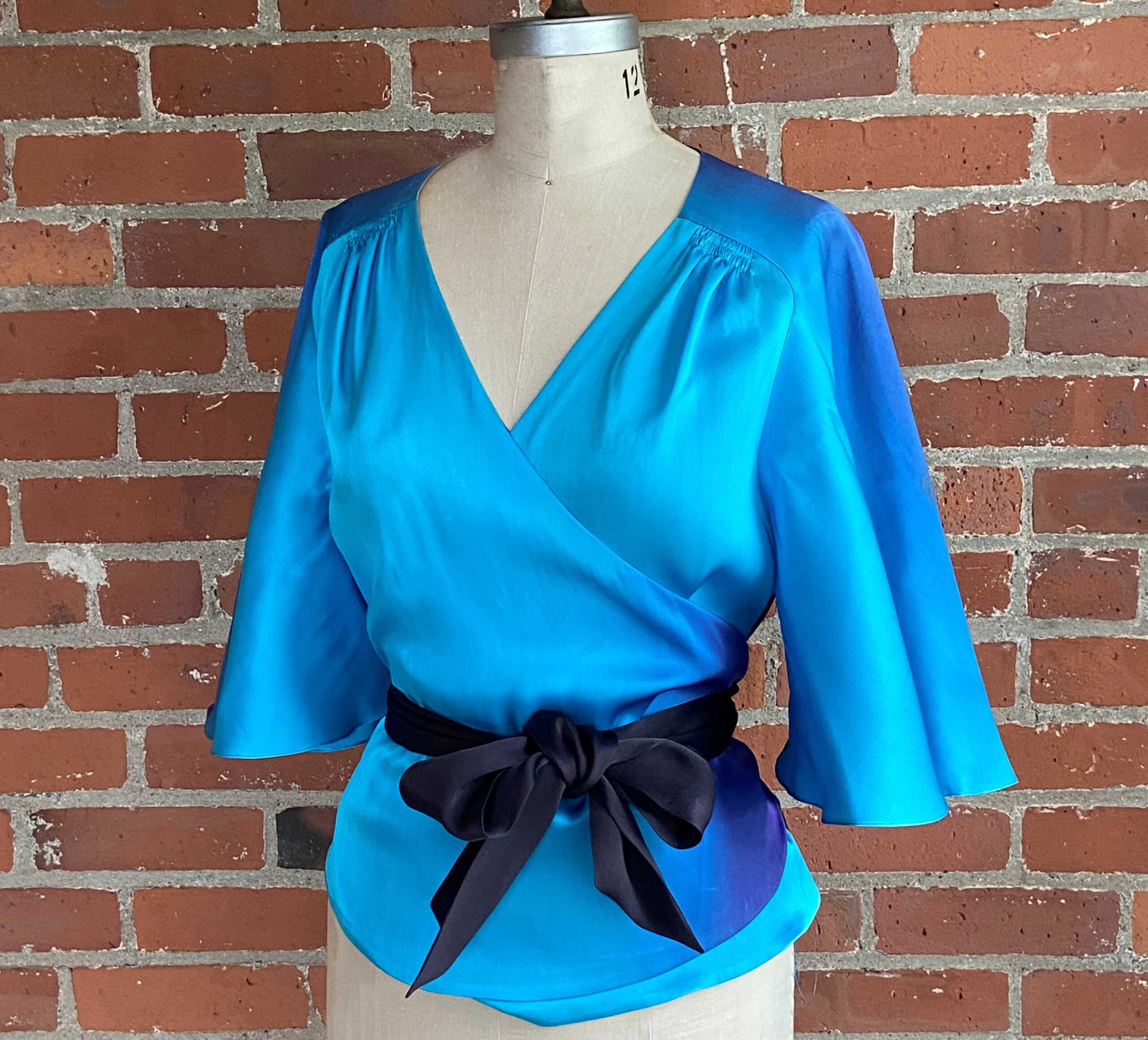 Decades of Style #3005 Butterfly Blouse with yoke seam, belted and on a dress form
