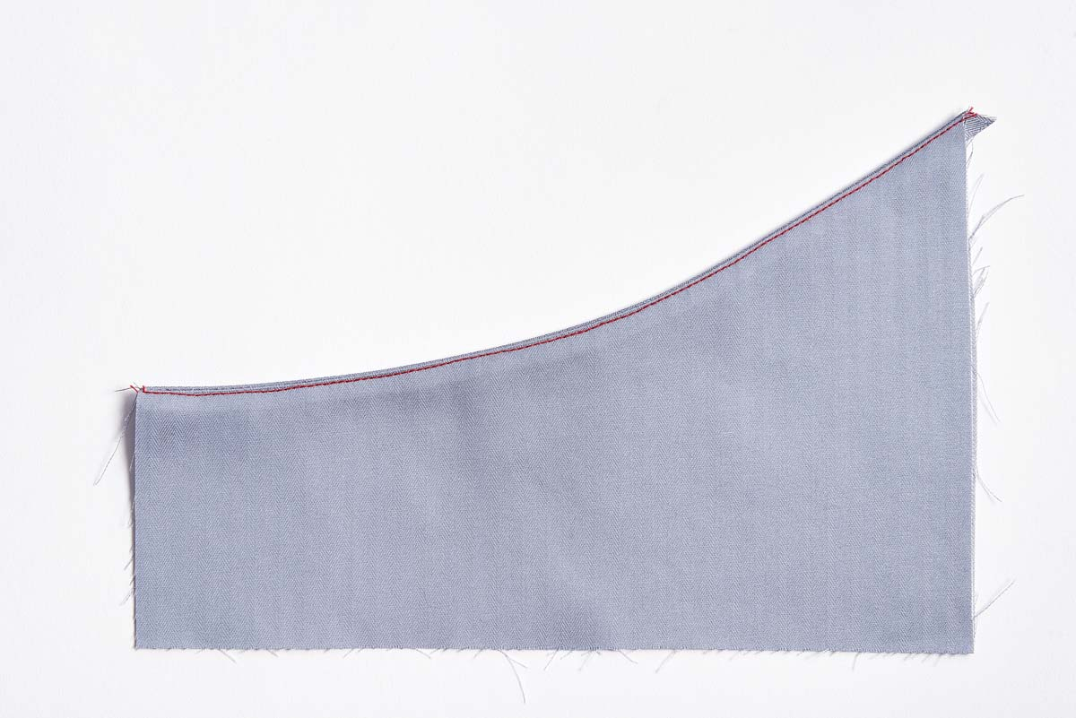 Skip clipping and understitch for smooth edges, as shown with red stitching line