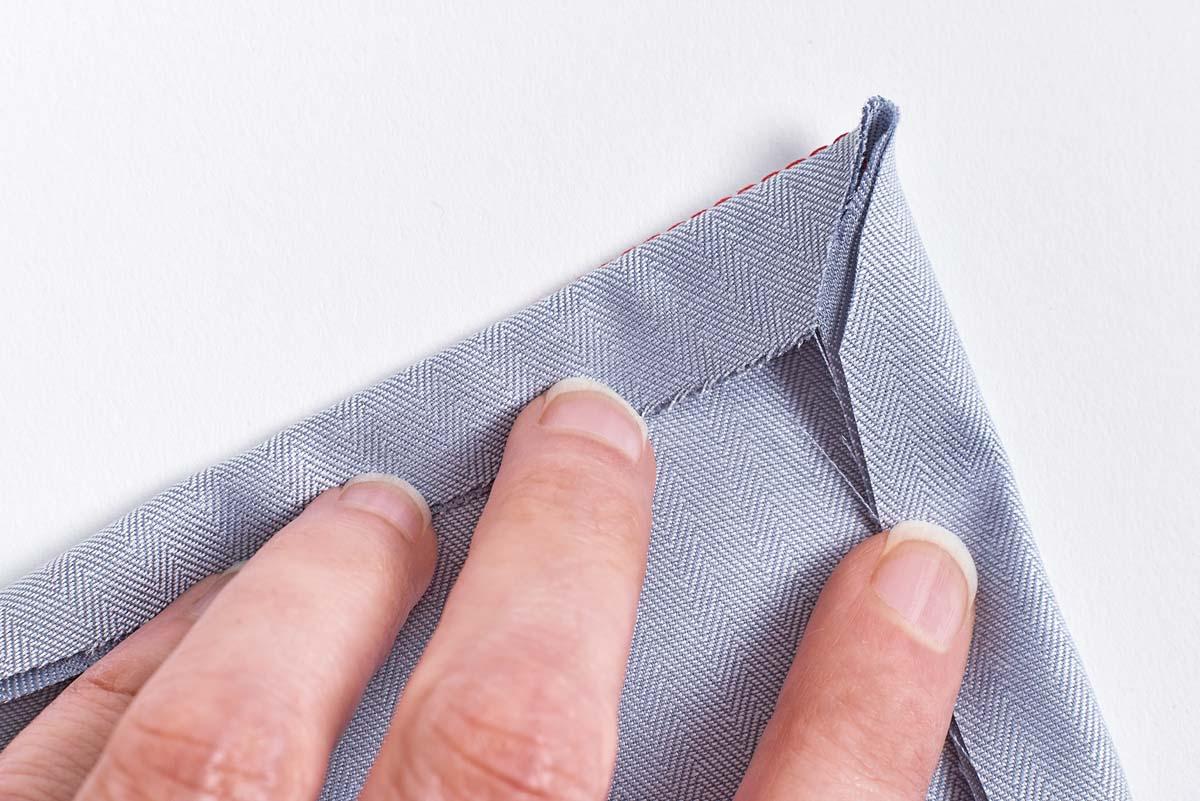 Fold and abut the corner seam allowances, then turn.