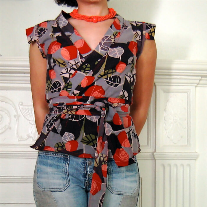 Woman wearing a bold print wrap top with a pair of jeans