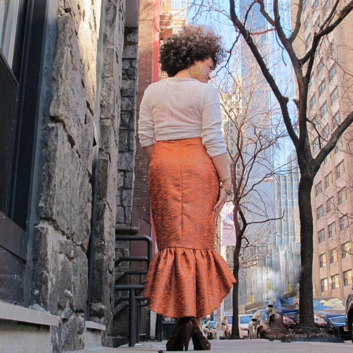 Marcy Harriell wearing pencil skirt with little ease and gathering at the back hem