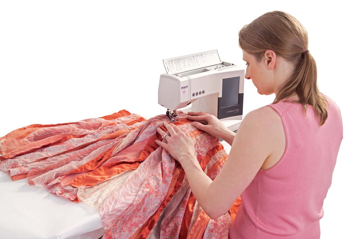 Sew through all layers of skirt fabric and interfacing to hold the pleats in place.