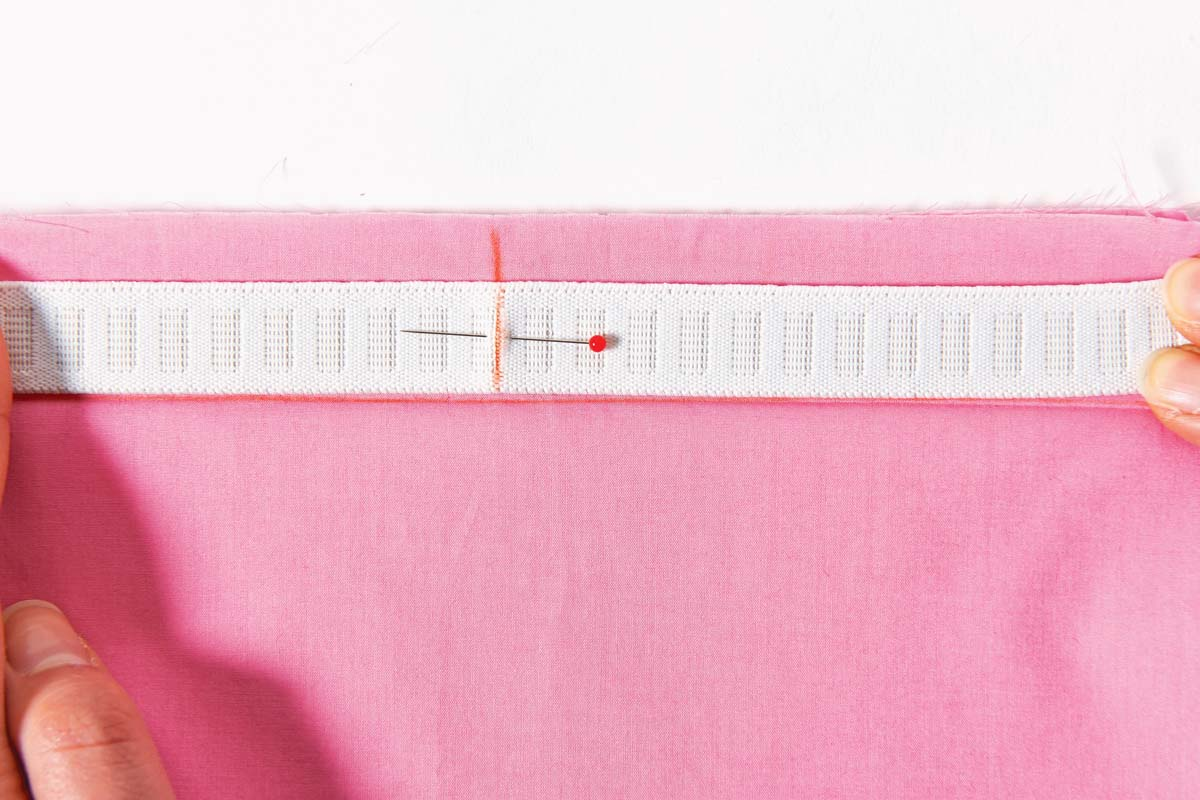 Match the markings on the garment and the elastic.