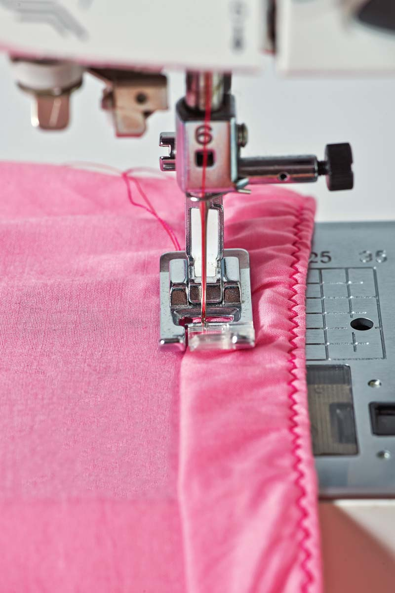 Stretch the elastic as you sew.